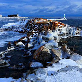 Grand Marais, Minnesota in winter by Shixing Wen - Landscapes Waterscapes ( ice formation, winter scene, minnesota, grand marais, lighthouse, lake superior, rock formation )