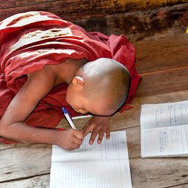 Myanmar by Diego Scaglione - Babies & Children Child Portraits ( pen, monk, copybooks, red, writing )