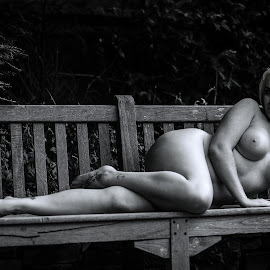 At the park by Paul Phull - Nudes & Boudoir Artistic Nude ( body, blonde, nude, black and white, park bench )