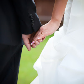 Young married couple holding hands by Cornel Achirei - Wedding Bride & Groom ( person, lovers, holding, valentine, husband, people, romance, together, caucasian, hand, love, woman, happy, affectionate, couple, men, dating, bride, passion, marry, ring, girlfriend, male, togetherness, romantic, white, happiness, finger, adult, ceremony, marriage, young, human, relationship, two, boyfriend, female, unity, dress, touching, wedding, wife, background, outdoors, matrimony, groom, engagement )