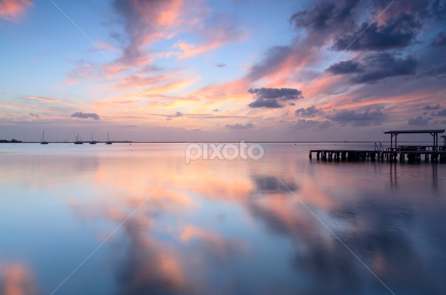 Reflections by Jeronimo Contreras Flores - Landscapes Waterscapes ( spain, sunrise, garyfonglandscapes, reflections, clouds, water, sea, morning, mar menor, ships, holiday photo contest, waterscape, photocontest, murcia, tranquility, quiet, colorful )
