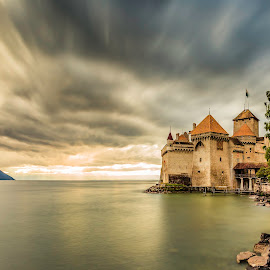 Chillon Castle by Nikolas Ananggadipa - City,  Street & Park  Historic Districts ( clouds, sunset, switzerland, long exposure, lake, castle, yellow, chateau )