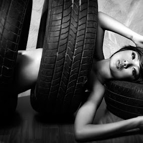 tyre by Singgih Purnomo - People Portraits of Women