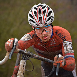 Powerless by Marco Bertamé - Sports & Fitness Cycling ( 2017, lars van der haar, orange, cyclo-cross, pushing, goggles, number, 13, helmet, championships, oranje, bicycle, luxembourg, uphill, muddy, mud, determined, uci, dutch, men, world, man, bieles )