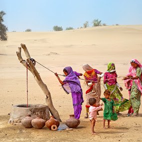 Water Pullers by Nayyer Reza - People Street & Candids ( color, colorful clothes, pitchers, well, nayyer, reza, dessert )