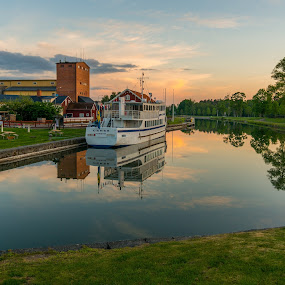 Calm waters by Nikos Diavatis - City,  Street & Park  Vistas ( mirrored reflections, sweden, borensberg, cloudscape, reflections, boat )