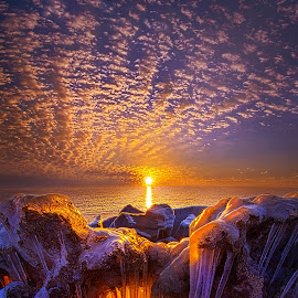 Beyond the Limits by Phil Koch - Landscapes Sunsets & Sunrises ( vertical, wisconsin, ray, icicles, yellow, travel, landscape, photography, sun, sky, life, ice, snow, emotions, weather, perspective, horizons, light, office, clouds, orange, park, heaven, colors, twilight, art, mood, white, horizon, journey, scenic, morning, living, portrait, shadows, country, field, winter, blue, serene, amber, sunset, outdoors, meadow, beam, lines, sunrise )