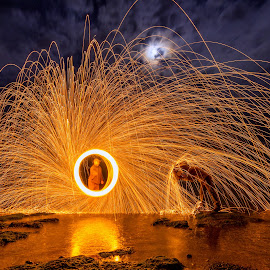 Fire! by Raluca-Suzana Buzoianu - Abstract Fire & Fireworks ( shore, moon, reflection, romania, circle, seaside, people, lights, night photography, steel wool, spin, long exposure, men, trails, sparks, constanta, rocks, light, water, abstract, clouds, wire, umbrella, lighttrails, steel, persons, fire, human, light painting, outdoor, fireworks, night )