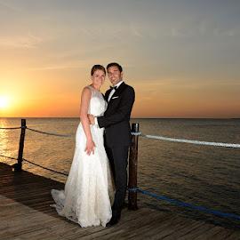 Zanzibar Pier by Andrew Morgan - Wedding Bride & Groom ( love, zanzibar, happy, sunset, wedding, paradise )