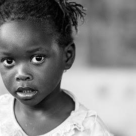 Sweet child girl by Sabina Lombardo-Salmina - Babies & Children Child Portraits ( looking, sweet, black and white, child portrait, senegal,  )