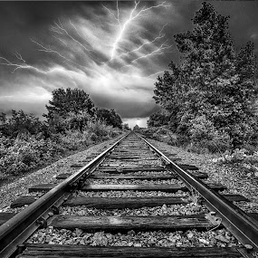 Lightning Express by Trevor Pottelberg - Landscapes Weather ( flash, train tracks, railroad, storm, heat, threatning, railroad tracks, sky, nature, frontal, t.pottelberg, cold front, wonder, train, severe, norfolk township, clouds, ominous, canada, t.pottelberg scenics, twilight, ontario, cn rail, breezewood, jackson side road, lightning, summer, trees, black and white, b and w, landscape, b&w, monotone, mono-tone )
