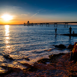 Love on the Rocks by Pete Watson - Landscapes Sunsets & Sunrises ( restoration, structure, victorian architecture, victorian pier, silhouette, clevedon, sea, architecture, seaside, south wales, coastal, coast, holiday, somerset, sunset, sundown, pier, summer, resort, west country, evening, restored )