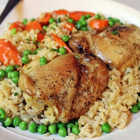 Healthy food. Baked chicken thighs with rice