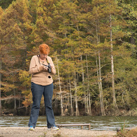 Checking Her Camera by Eva Ryan - People Street & Candids ( water, broken_bow, female, oklahoma, woman, trees, dock, river,  )