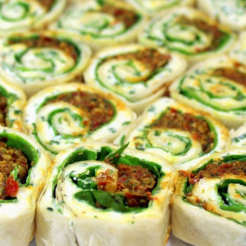 Spiral Spinach and Cheese Bites with Sun Dried Tomato Pesto
