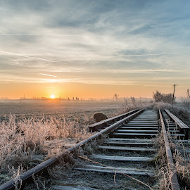 Sunrise at the forgotten railway during winter. by Piotr Jankowiak - Landscapes Weather ( wheat, clouds, tory, zima, mróz, most, wschód, zboże, landscape, frozen, sun, siano, winter, sky, pole, railway, cold, kolej, stóg siana, słońce, bridge, sunrise, krajobraz, przymrozek )