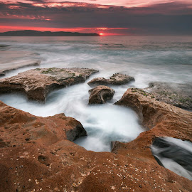 Pink In The Sky by Geoffrey Wols - Landscapes Sunsets & Sunrises ( slow shutter speed, clouds, pearl beach, espiritu santo, australia, nsw, pink, central coast, rocks )