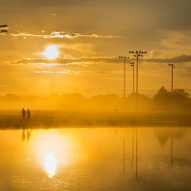 Morning Run by Timothy Hess - City,  Street & Park  City Parks ( reflections, yellow, sunrise, running, golden, sun )