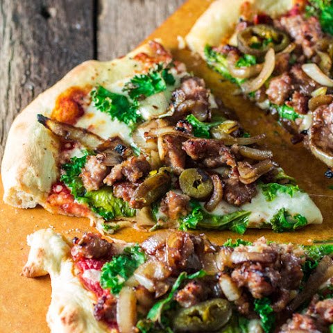 Italian Sausage Pizza with Caramelized Onions, Kale and Jalapeños