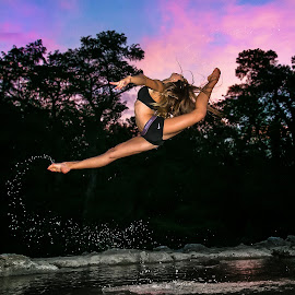 Gymnast leaping in water by Chris Reilly - Sports & Fitness Fitness ( water, clouds, sky, sunset, lake, gymnastics, gymnast, river )