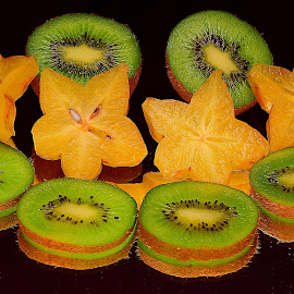 Kiwis and star fruits combo. by Andrew Piekut - Food & Drink Fruits & Vegetables