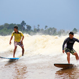 Surfing in the river by Zakaria Juniarto - Sports & Fitness Surfing