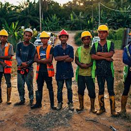 The Man Behind of Hardship. by Md Khairul Qayyum - People Portraits of Men ( hardwork, safety boot, boot, red, yellow, safety helmet, helmet, people, man, safety vest, vest )