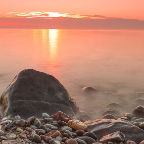 Sunset Over Baltic Sea by Sami Rahkonen - Landscapes Waterscapes ( water, warm, smooth, waterscape, colors, wallpaper, beautiful, sea, stone, ocean, beach, landscape, sun, island, soft, baltic sea, sky, nature, gotland, fog, sunset, summer, hot, stones )