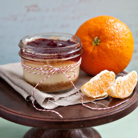 Orange–White Chocolate Cheesecakes with Cranberry Sauce