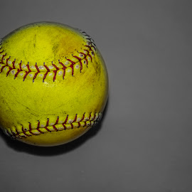 Softball by Mary Spencer - Sports & Fitness Other Sports ( copy space, ball, sports, softball, equipment, yellow, used, grey background )