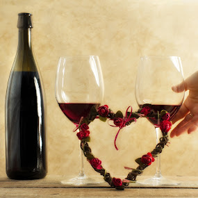 valentine's day concept by Donatella Tandelli - Food & Drink Alcohol & Drinks ( valentine's day, rendez-vous, concept, sepia background, decorative, red wine, wood, holidays, party, seduce, love, transparency, woman, drink, tasting, couple, gold, lunch, heart, decoration, body part, romantic, hhand, delicious, bottle, bracelet, luxury, dinner, beverage, female, alcohol, deluxe, floral, engagement )