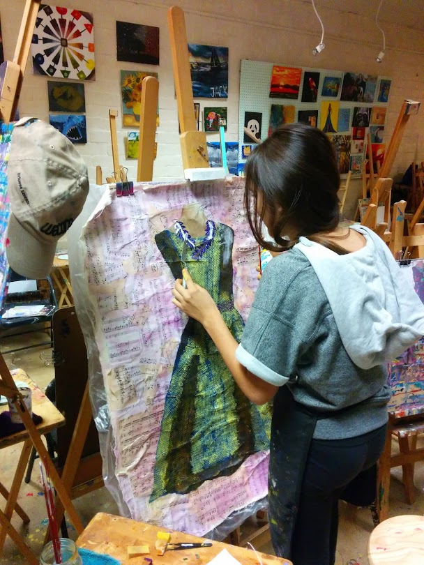 Working on a mixed media dress painting