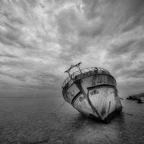 The abandoned chip by Nikos Diavatis - Transportation Boats ( cloud formations, b&w, clouds and sea, sea, abandoned )