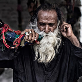 Devotee at Sehwan Shareef  by Yuni  Khan - People Portraits of Men ( devotees, yuni khan, yuni's photography, malangs, Travel, People, Lifestyle, Culture )