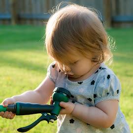 by Jennifer  Loper  - Babies & Children Children Candids ( toddler, white, sprayer, grey dress, grass, black, hose, summer )