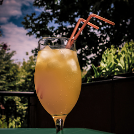 Sun kissed by Suzana Trifkovic - Food & Drink Alcohol & Drinks ( straw, sunny, ice cube, drink, glass, yellow, soda )