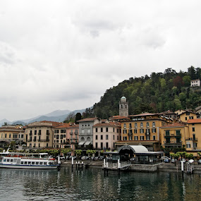 Bellagio by Serguei Ouklonski - City,  Street & Park  Street Scenes ( port, reflection, old, europe, harbor, ship, no person, architecture, house, travel, cityscape, spring, city, cloud - sky, watercraft, buildings, italy, water, lombardy, building, church, lake, traditional, tourism, boat, urban, landmark, tower, outdoors, town, waterfront, streetview architecture )