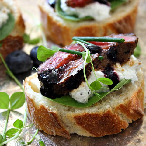 Peppercorn Steak Crostini with Blueberry Balsamic Sauce