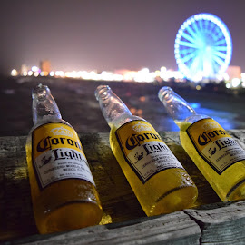 On the pier by Michelle Bergeson - Food & Drink Alcohol & Drinks ( beer, blue, night, yellow, ferris wheel,  )