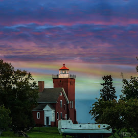 Two Harbors lighthouse by Glenda Clausen - Buildings & Architecture Public & Historical ( colors, sunset, light house, lake superior, boat )