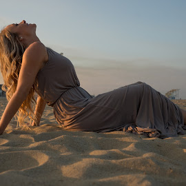 Laying on the beach by Frank DeChirico - People Portraits of Women (  )