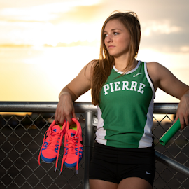 Sunset Handoff by Bob Grandpre - Sports & Fitness Running ( track shoes, woman, baton, sunset, relays, track )