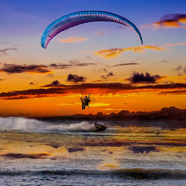 Men and Machine by Len  Janes - Sports & Fitness Other Sports ( motorised, water, flying, machinery, watersports, fly, sunset, motor, kite, jetski, sea, men, machine, flying machine, colours )