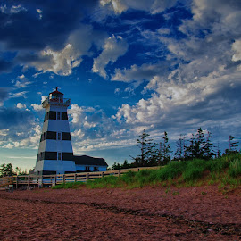 West Point Lighthouse by Hali Moore - Buildings & Architecture Other Exteriors ( clouds, blue sky, canada, sunset, canadian, lighthouse, july, beach, landscape, pei, west point lighthouse )
