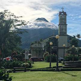 The Volcano and the Church by Johannes Oehl - Instagram & Mobile iPhone ( garden bench, fountain, beauty, physical science, christianity, panoramic, deep focus, catholicism, scenic, america, ecotourism, cloud, sun light, beautiful, adventure tourism, mountain, stratovolcano, furniture, la fortuna de san carlos, latin america, weather, cityscape, globe-trotting, alajuela, cirrus cloud, portal, sunny, sky, parque de la fortuna, la fortuna, journeying, bench, natural light, arenal volcano, cityscape-photography, geotourism, beauty in nature, panorama, central america, outside, color image, lawngreen, composite volcano, daytime, lawn, creative image, blue sky, mountain peak, bell tower, adventure and extreme, responsible tourism, wildlife tourism, church, tropical zone, magnificent, costa rica, roman catholic church, national park, volcanology, streetlamp, nature and rural, car, general view, volcano, jungle tourism, lightskyblue, park, architecture, fair weather, lamppost, green, famous, public park, earth science, cross, tropical climate, two objects, peak, sustainable tourism, afternoon, garden ornaments, outdoor, tropical, cloudy, low-impact, dormant, blue, outdoors, landscape-photography, tropics, panoramic view, exterior view, catholic church, landscape, arenal volcano national park,  )