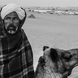 camel man by Prabhat Kumar - People Portraits of Men ( black and white, rajasthan, people )