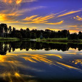 Delicate Flames by Derrill Grabenstein - Landscapes Sunsets & Sunrises ( landcape, sunset, orange clouds, pond )