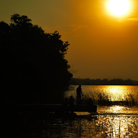 lighting photography by Arun Guna - Nature Up Close Water ( nature, silhoutte, people, sun )