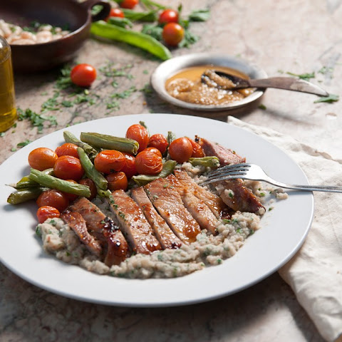 Honey & Mustard Pork With Butterbean Mash & Roasted Tomatoes