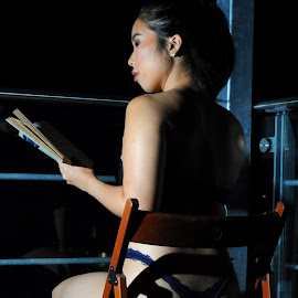 Scholar of the Night by DJ Cockburn - People Portraits of Women ( reading, thong, home shoot, off-camera flash, chinese, asian, chair, lingerie, sitting, woman, book, night, balcony )